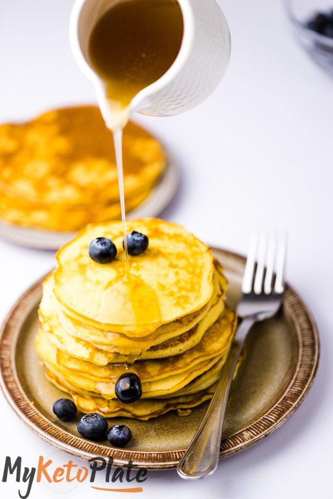 The keto pancakes are extra fluffy, thick and delicious. Enjoy coconut flour pancakes topped with tons of butter and drown them in carb-free syrup!