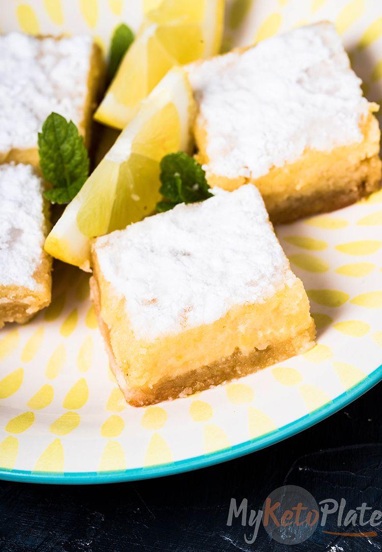 Keto Lemon bars on a plate with a sliced lemon and mint leaves