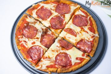 This keto pizza with fathead dough is super easy to make at home. The dough needs only four ingredients, and it tastes just like the real thing. It's crispy, chewy and delicious. Add all your favorite toppings, and you will enjoy a slice of heavenly delicious pizza with just three net carbs.